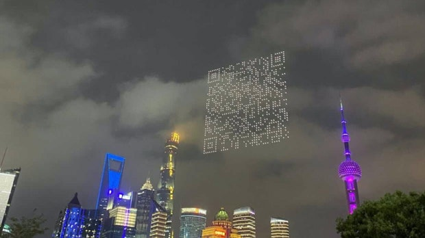 Drones hovered over Shanghai's futuristic backdrop and a QR code became visible